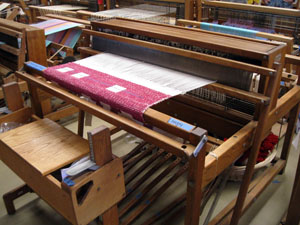 """Walling 45"""" floor loom with 8 shafts and 10 treadles with """"cam-action"""" the """"Loom Harness Lifting Apparatus"""" patented by Bill Walling in 1960."""