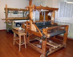 Two looms in a room of a Saldus weaving studio. One in rear typical of those found on farms.