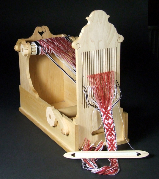 Hole-and-slot tape loom based on examples from European folk-history museums. Built by Fred Hatton.