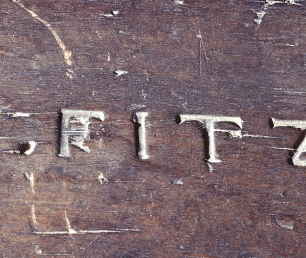 """W. FITZ"" mark on top of table."