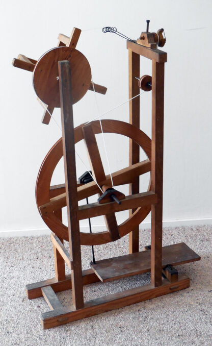 """The """"Asian spinning wheel"""" with drive bands fitted."""