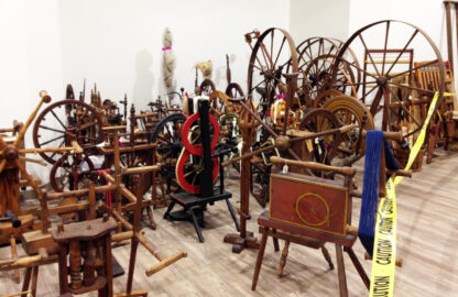 Henzie Collection spinning wheels and reels waiting to be arranged.