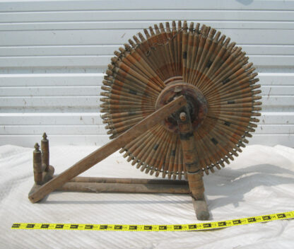 Small spindle spinning wheel as found and unrestored. Diagonal braces are not original.