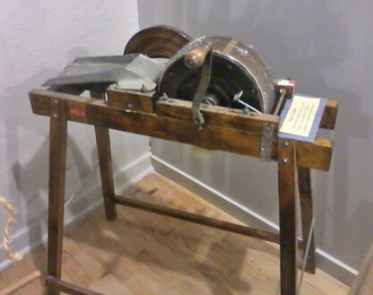 Spin-Well bench carder Courtesy of Camrose & District Centennial Museum , Camrose, Alberta.