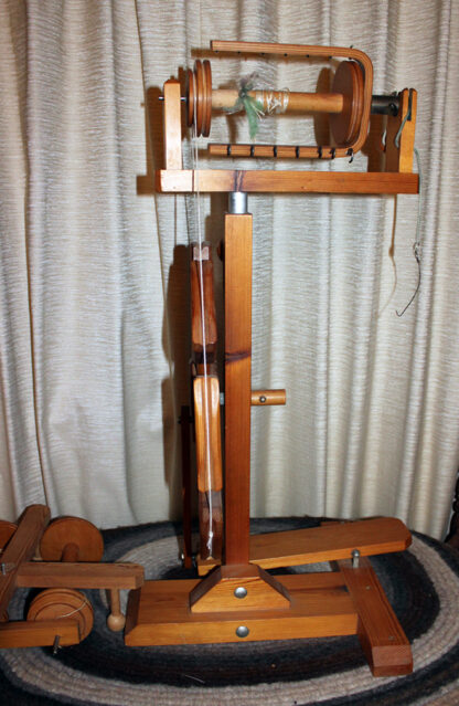 Moswolt spinning wheel side view.