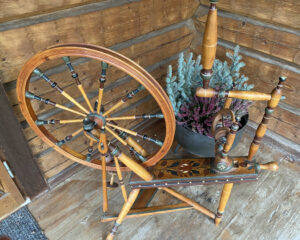 Hjulbäck wheel with floral design painted on top of table