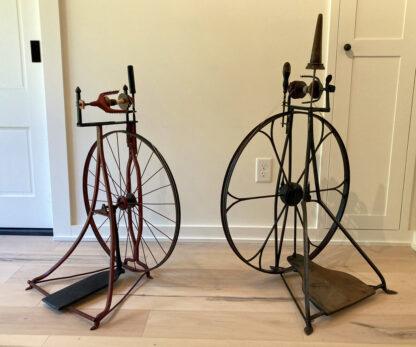 Two Swedish upright metal wheels